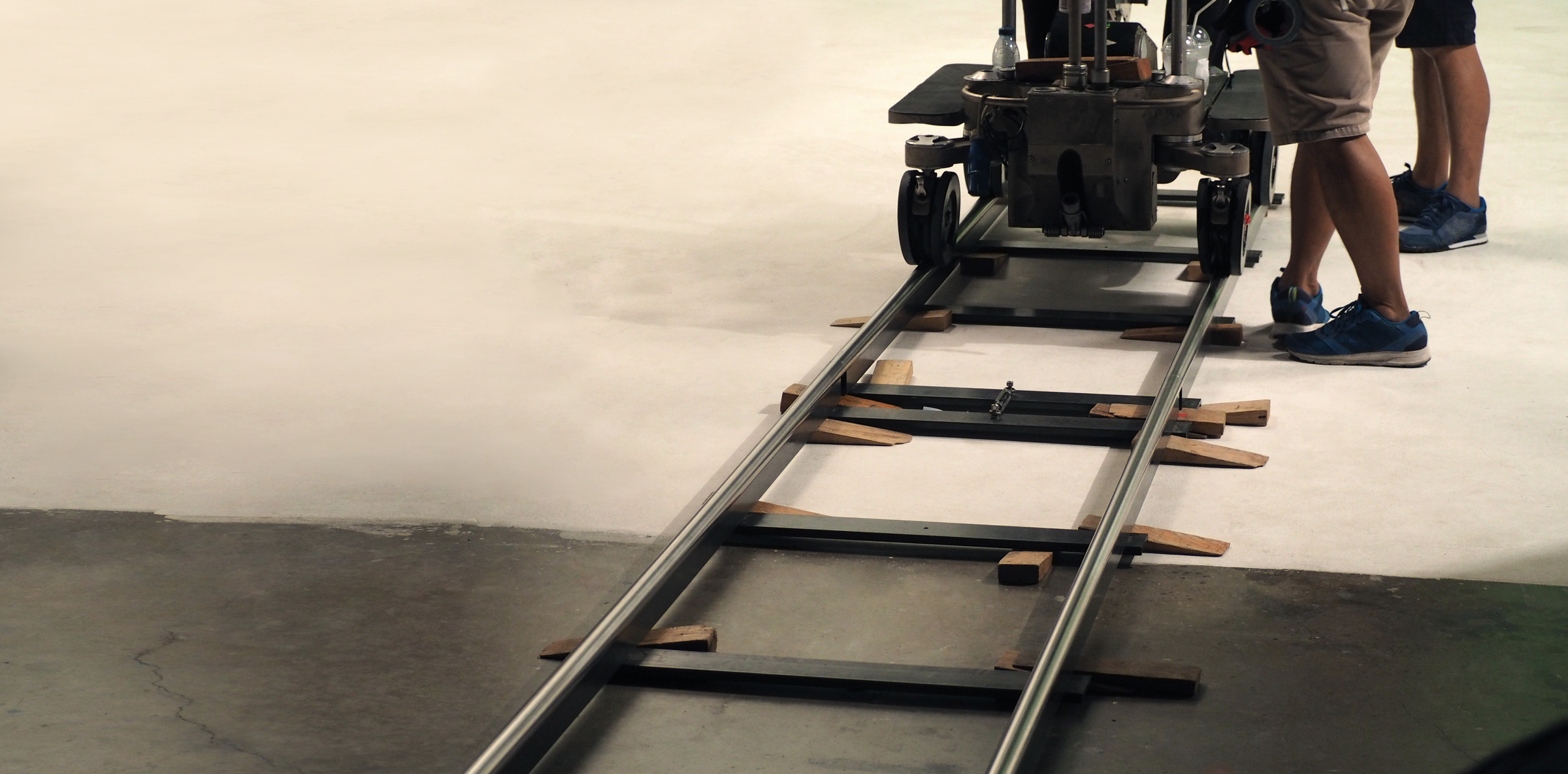 Behind the scenes of production team setting dolly track